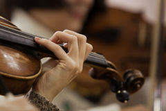Hand girl on the strings violin Royalty Free Stock Photo