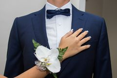 Prom party - two friends. The hand of the girl and the suit of the boy Royalty Free Stock Photos