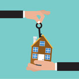 Hand Give Key And Home. House Buying Royalty Free Stock Image