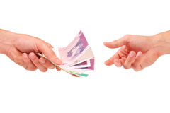 Hand give money to another Stock Image