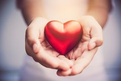 Hand give red heart for love.  Royalty Free Stock Images