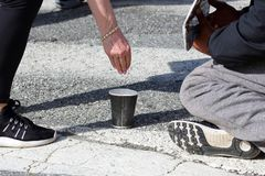 Hand gives alms to the poor man. The hand gives alms to the poor man stock photos