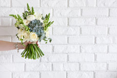 Hand gives bunch with white roses and succulent stock image