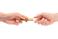 Hand gives credit card to another hand Royalty Free Stock Photos