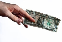 Hand gives dollar bill Royalty Free Stock Photo