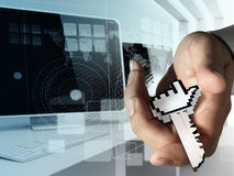 Hand gives Internet access key Stock Photo