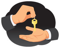 Hand gives the key. Businessman hand provides the key to the real estate buyer Stock Photography