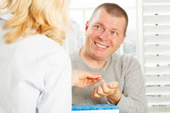 Hand gives a patient man the medicine Stock Photos
