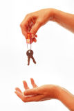 Hand giving away house keys Stock Photos