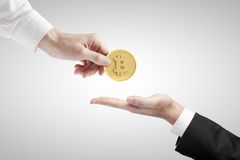 Hand giving bitcoin Stock Photography