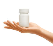 Hand is giving bottle for pills Royalty Free Stock Image