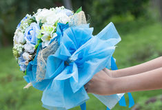 Hand giving bouquet of beautiful flower Royalty Free Stock Images