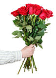 Hand giving bouquet of many red roses isolated Stock Photo