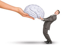 Hand giving brain to businessman Royalty Free Stock Image
