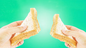 Hand giving bread Royalty Free Stock Photos