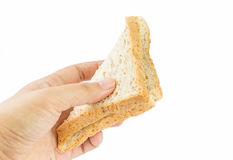 Hand giving bread Royalty Free Stock Images