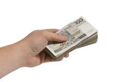 Hand giving a bribe, heap of money, corruption Stock Photos