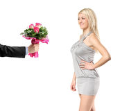 Hand giving a bunch of flowers to a woman Royalty Free Stock Images
