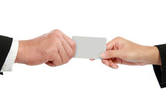 Hand giving a business card. Isolated over white background Royalty Free Stock Photos
