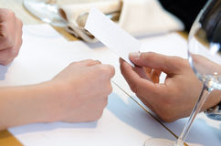 Hand giving business card Royalty Free Stock Image