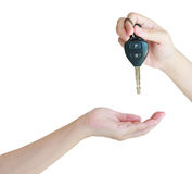Hand giving a car keys to another Stock Images
