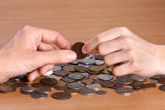 Hand giving a coin to another person, closeup Stock Image