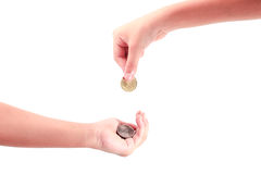Hand giving a coin to another person Stock Photography
