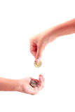 Hand giving a coin to another person Stock Photos