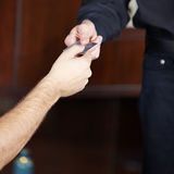 Hand giving credit card to waiter Stock Images