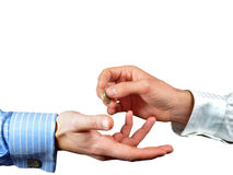 Hand giving or donating one euro. Hands exchanging one euro coin for payment or donation Royalty Free Stock Photography