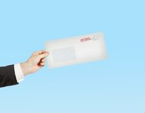 Hand giving a envelope Royalty Free Stock Image