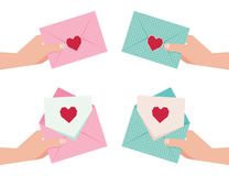 Hand giving an envelope with Valentine card Stock Image