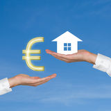 Hand giving euro for housing Stock Images