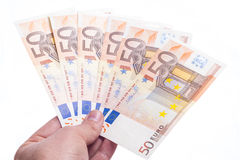 Hand giving fifty euro fan Stock Image