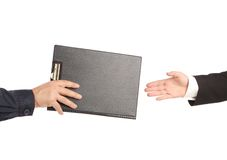 Hand giving a folder. Royalty Free Stock Images