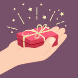Hand giving a gift Royalty Free Stock Photo