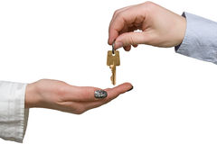 Hand giving a golden key to another hand Stock Images