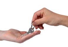 Hand giving a house key Stock Photos