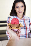 Hand Giving Ice Cream To Female Customer Royalty Free Stock Images