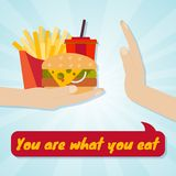 Hand giving junk eating. Food choice concept. You are what you eat Stock Photo