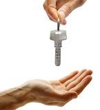 Hand giving key Royalty Free Stock Photos