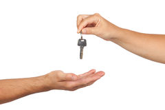 Hand giving a key. Isolated on white background Royalty Free Stock Photos