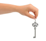 Hand giving key Royalty Free Stock Images