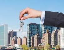 Hand giving key Stock Photo
