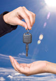 Hand giving key - concept Stock Photo