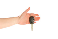 Hand giving a key isolated on white Stock Photos
