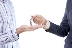 Hand giving a key isolated Stock Image