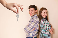 Hand giving a key young couple stock image