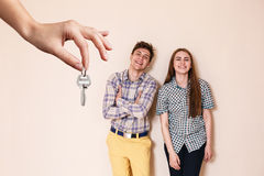 Hand giving a key young couple Royalty Free Stock Images