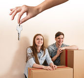 Hand giving a key young couple royalty free stock photography